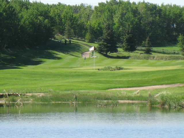 A view over the water of the 5th and 3th hole at Nursery Golf and  Country. Nursery Golf and Country Club in Lacombe  Nursery Golf   Country Club