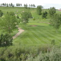 A view of a fairway and a green with narrow path on the left side at Trochu Golf and Country Club