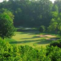 View of a green and bunker at Glen Abbey Golf Club
