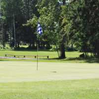 A view of a green at Pigeon Lake Golf Club