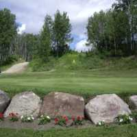 A view of hole #13 with narrow cart path on the left side at Pipestone Golf Club