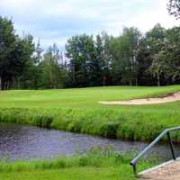 A view over the water of a green at Championship from Black Bull Golf Resort