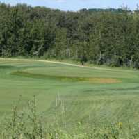 A view of the 14th green at Tooth of the Dogpound Creek Golf Course