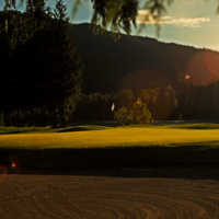 Sunset over hole #9 at Revelstoke Golf Club