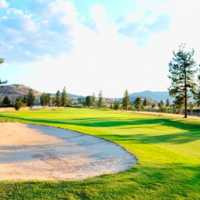 View of a green and bunker at Eaglepoint Golf Resort