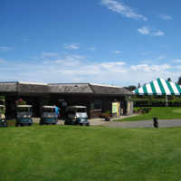A view of the clubhouse at Mulligans Golf Club