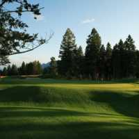A sunny day view of a hole at Eagle Ranch Golf Course